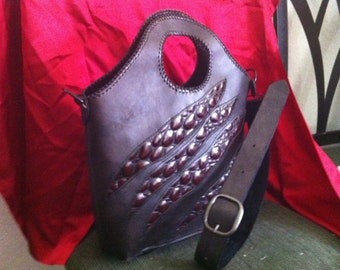Slashed leather bag