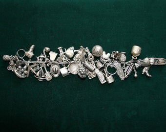 Vintage 1930's Sterling Silver Charm Bracelet with 41 CharmsVintage 1930's Sterling Silver Charm Bracelet with 41 Charms