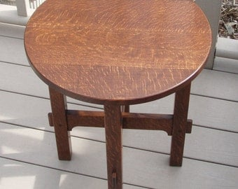 A reproduction Stickley 603 Tabouret.