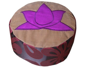 Meditation cushion. Purple lotus on okergeruite surface.