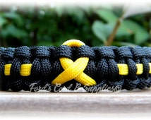 Yellow Awareness Ribbon Paracord Bracelet Support Troops, POW MIA, Suicide Prevention, Sarcoma, Spina Biffida, Bladder Cancer, Liver Cancer