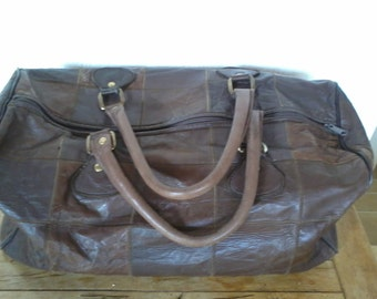 Beautiful travel bag in soft leather brown color