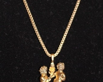 "Vintage Monet 18"" necklace with boy & girl holding flower"
