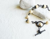 Glass beaded bracelet (milky glass beads and gun-metal T-bar clasp) - glass beads