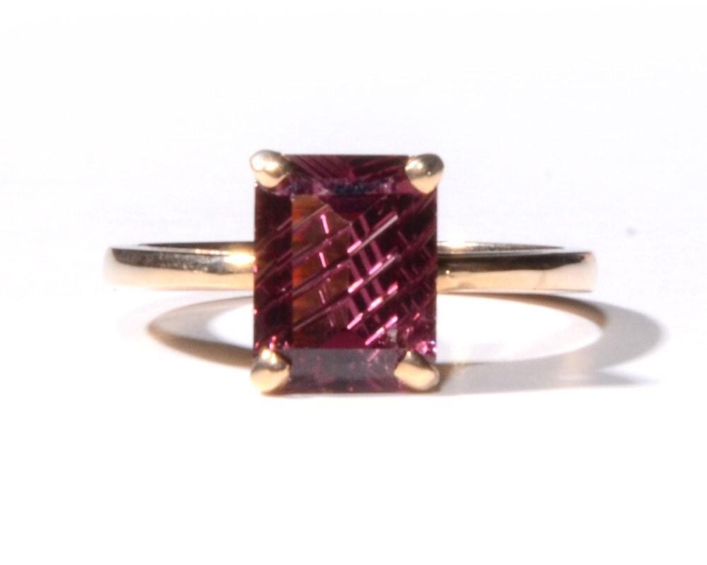 emerald cut garnet ring 1496