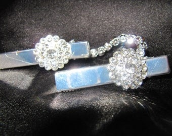 Formalwear Clips (pearls or rhinestones) to hold stole/wrap/cape in place