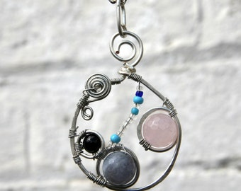 Circular freeform art jewellery hand faceted blue and pink Quartz silver plated pendant with Onyx, and chain to a length of your choosing.