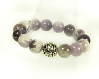 "Amethyst Gemstone Stretch Bracelet With Designer ""Bling"" Ball."