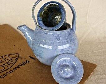 Handmade ceramic teapot with tea strainer