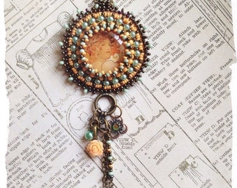 Bead embroidered Orange/peach Mucha Ladypendant