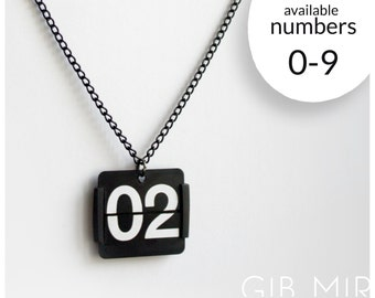 necklace made from an old flip clock (Number 0-9) jewelery