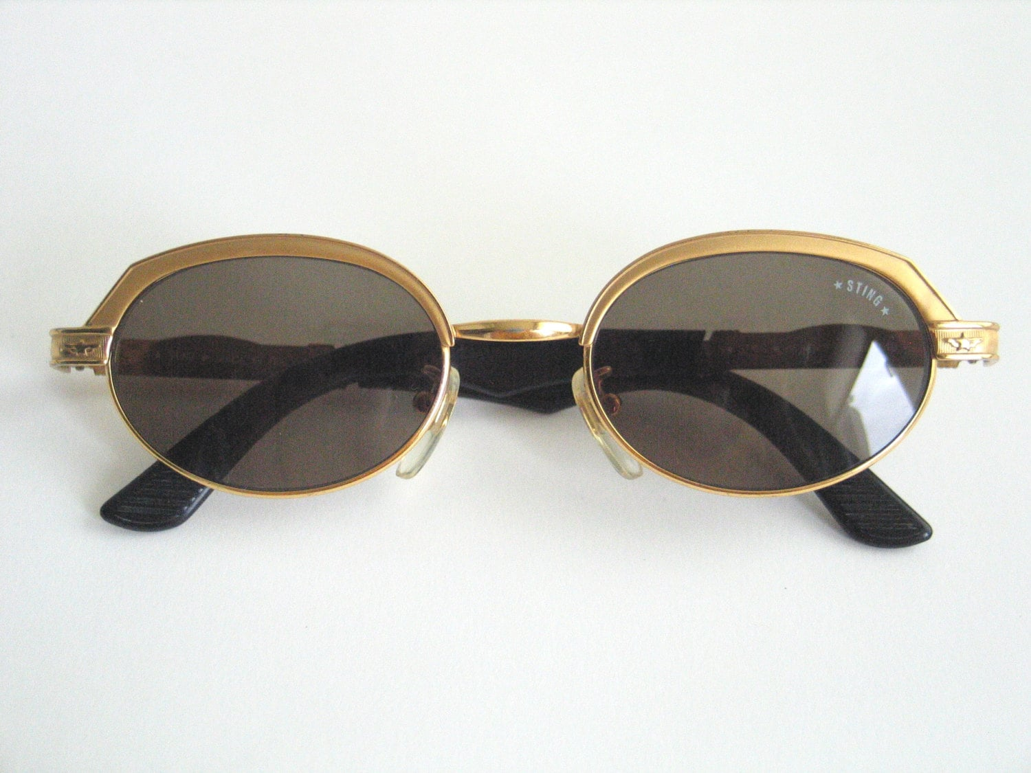 Sting vintage unisex sunglasses. Gold frame and grey-brown