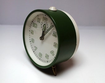 Vintage green mechanical alarm clock 1970