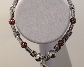 silver coloured metal beads and copper coloured balls.