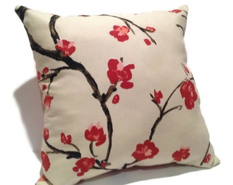 Red White Throw Pillow with a Red and Pink Floral Pattern