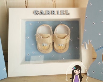 memory frame with the first baby shoes
