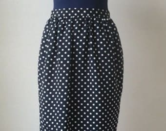 black and white polka dot pencil skirt.