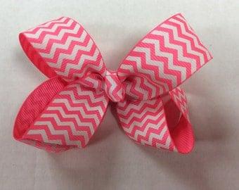 "3.5"" Bright/neon pink chevron print little girl bow."