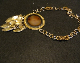 Necklace with brown agate central. Chainmaille and scales anodized aluminum