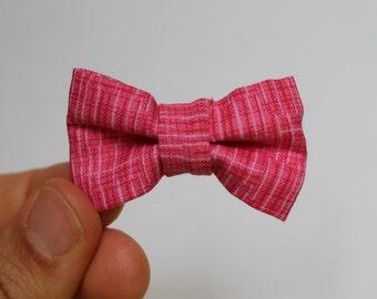 Bright pink crosshatch fabric bow on elastic headband, baby, girl