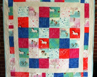 Wee Wander patchwork quilt for baby made from Michael Miller Sarah Jane collection designer fabrics.