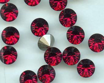 1028 SS39 RU***  6 Swarovski rhinestones point back SS39 (8,3mm) ruby