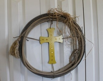 Western Rope Wreath.  Cross with raffia bow wreath.  Western cross and rope wreath.  Rustic raffia, bling, cross, rodeo rope decor.