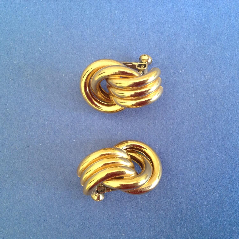 gold tone knot earrings by scavengeraesthetic on etsy