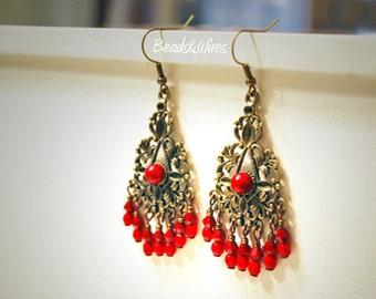 Bronze chandelier earrings and small red beads