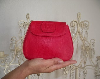 Mini red leather pouch.