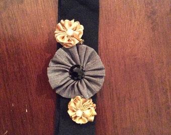 Black and gold flowered headband