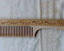 Wooden comb with birch bark lace.