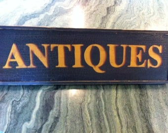 "Black & Gold Lettering Advertising ""ANTIQUES"" Sign (23x7"")"