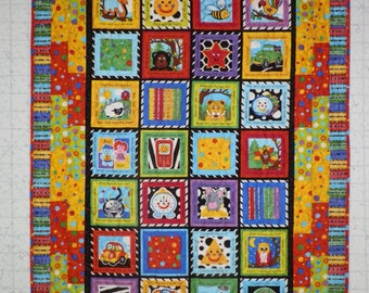 "36x53 Colorful quilt with ""What does the ? say"" center."