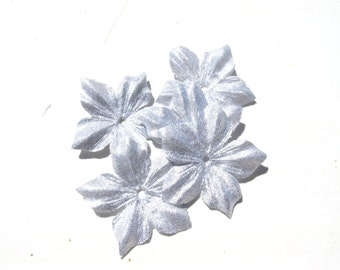 2 flower shaped silver lamé clear size 35 mm