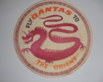 Vintage 1970's QANTAS fly to The Orient drink coaster. Used. Dragon logo, double sided