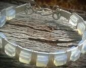 Child's imitation moonstone cube bracelet