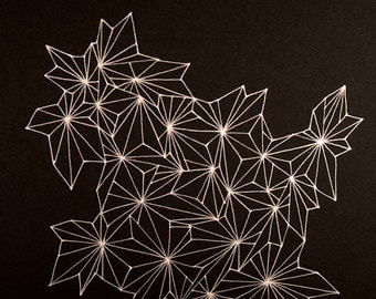Geometric Abstract Drawing in Silver on Black Paper