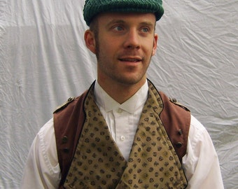 Flat cap in forest green made with upcycled cotton corduroy