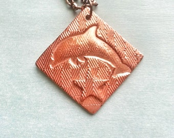 "Square dolphin copper pendant with nautical star design with patterned layers, handmade 1.45"" diameter copper piece on darkened copper chain"