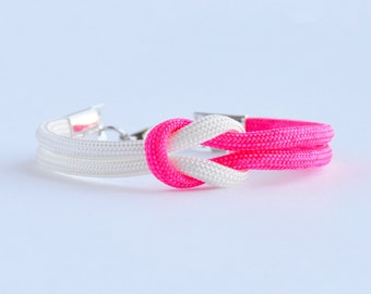 Neon hot pink and white forever knot parachute cord rope bracelet