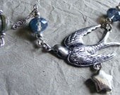 Star and swallow necklace - mixed media, ceramic, czech beads, sterling silver and silver ox plated silver.