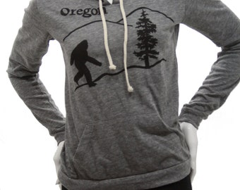 Oregon Bigfoot| Lightweight pullover hoodie| sasquatch| Art by MATLEY| Soft organic cotton bln| classic style| Pacific Nortwest| Travel tee.
