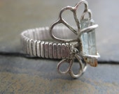 Rough Naturally Faceted Aquamarine set on a Filigree Sterling Silver Band - Ring Size 6