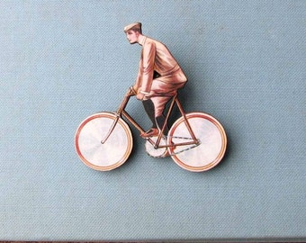 antique french style guy on a bicycle tie tack . bicycle brooch pin . cyclist jewelry