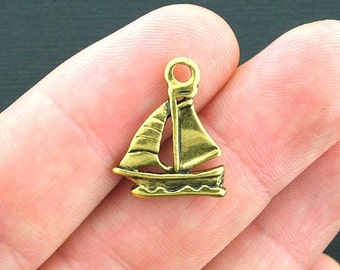 8 Sailboat Charms Antique Gold Tone 2 Sided - GC411