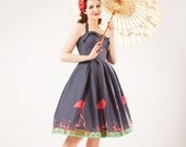 50s reproduction dress with flamingos on the skirt, halter neck and full skirt, all sizes from US 0 to 16
