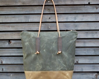 Waxed canvas tote bag with leather handles and zipper closure