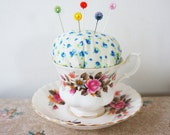 Teacup and saucer pincushion with dress marker pins