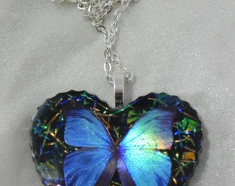 Faux dichroic blue butterfly resin pendant
